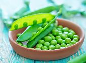 stock photo of pea  - green peas in bowl and on a table - JPG