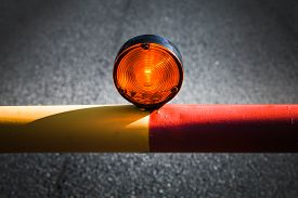 picture of safety barrier  - Red light on the automatic barrier no way signal over dark asphalt road - JPG