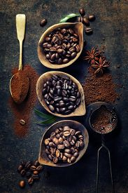 pic of pot roast  - Top view of three different varieties of coffee beans on dark vintage background - JPG