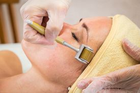 image of cosmetology  - Girl with a beautician at spa salon - JPG