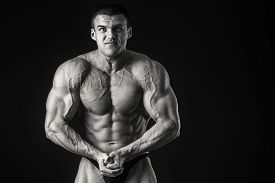 pic of strongman  - Strongman on a black background - JPG