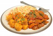Indian chicken jalfrezi with potato curry and rice