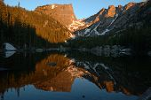 stock photo of rocky-mountains  - sunrise reflection at dream lake rocky mountain national park colorado - JPG
