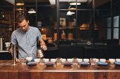 ������, ������: Barista preparing coffee tasting with rows of cups and beans