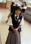 Young girl in private school uniform