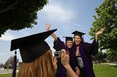 Female graduates taking pictures