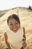 image of human face  - Senior woman smiling for the camera outdoors - JPG