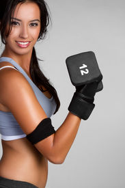 foto of weight-lifting  - Fit exercising woman lifting weights - JPG