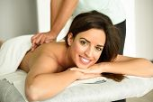 Young Woman Receiving A Back Massage In A Spa Center. poster