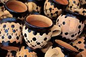 Pile Of Handpainted Red Clay Coffee Mugs
