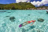 Luxury paradise travel vacation bikini woman relaxing snorkeling in idyllic ocean coral reefs at lux poster