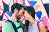 Happy couple in love taking a selfie doing funny kissing pose at famous tourist attraction Berlin wa poster