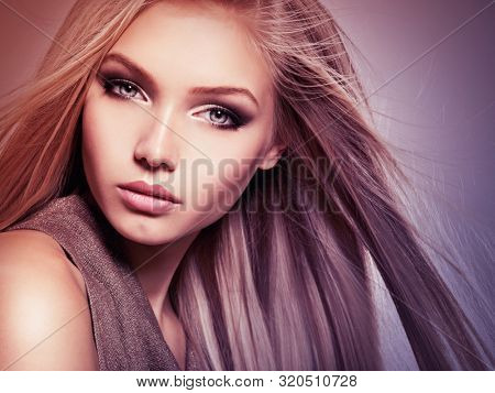 poster of Face of the Beautiful young woman with long straight  hair. Closeup portrait of a pretty girl over c