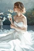Perfect Bride, Portrait Of A Girl In A Long White Dress. Beautiful Hair And Clean Delicate Skin. Wed poster
