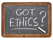 Got ethics question - white chalk handwriting on a vintage slate blackboard, isolated