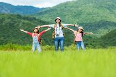 Group Asian Family Children Raise Arms And Standing See Mountain Outdoors, Adventure And Tourism For poster