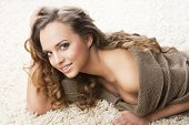 Sweet Young Girl Laying On Carpet She Smiles