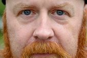 Close Up Cropped Portrait Of A Redheaded Man poster