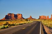 Empty scenic highway in Monument Valley, Arizona, USA poster