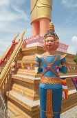 picture of brahma  - Brahma image in front of large standing Buddha at Phnom Yat in Pailin Cambodia - JPG
