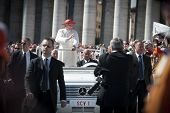 Pope Benedict XVI blessing with guards