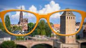 An image of orange glasses sharp and blurred Strasbourg scenery poster
