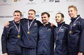 KIEV, UKRAINE - APRIL 14, 2012: USA men's epee team on medal ceremony during World Fencing Championship on April 14, 2012 in Kiev, Ukraine