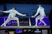 KIEV, UKRAINE - APRIL 14, 2012: Fight between Weston Kelsey, USA, and Gauthier Grumier, France, during final match of World Fencing Championship on April 14, 2012 in Kiev, Ukraine