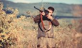Hunting Equipment For Professionals. Hunting Is Brutal Masculine Hobby. Man Aiming Target Nature Bac poster