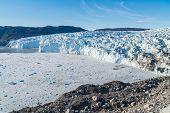 Greenland Glacier front of Eqi glacier in West Greenland AKA Ilulissat and Jakobshavn Glacier. Drain poster