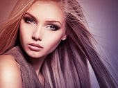 Face of the Beautiful young woman with long straight  hair. Closeup portrait of a pretty girl over c poster