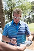 JACKSONVILLE, FLORIDA-APRIL 14: Gary LeVox, lead vocalist of Rascal Flatts, signing autographs at the Tim Tebow Foundation Celebrity Golf Classic on April 14, 2012 in Jacksonville, Florida.