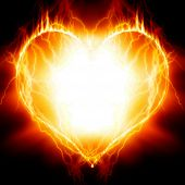 stock photo of soulmate  - Heart on fire on a dark background - JPG