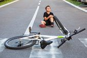 Kid Hurts His Leg After Falling Off His Bicycle. Child Is Learning To Ride A Bike. Boy In The Street poster