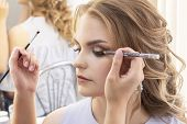 Makeup Artist Puts Make Up On Girl Model. Wedding Makeup, Evening Makeup, Natural Makeup. Make-up Ar poster