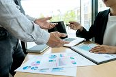 In Business Office Businessman In Meeting Analyses Chart poster