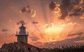 Amazing Sunset With Sunbeams And Lighthouse In Makarska, Croatia poster