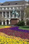 Budapes, Kossuth square: colorful flowerbed and the equestrian statue of the national hero Francis I