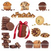 Large collection of chocolate cookies, biscuits, candy and muffin cakes isolated over white background.