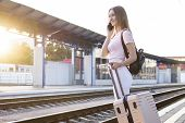 Young Attractive Girl Is Standing With Luggage At The Station And Waiting For The Train, The Student poster