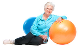 stock photo of beautiful senior woman  - senior woman resting after exercises In gym - JPG