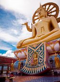 stock photo of higher power  - Golden statue of Buddha sitting - JPG