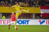 VIENNA,  AUSTRIA - OCTOBER 16:  Sergei Gridin (#11 Kazakhstan) kicks the ball during the WC qualifie