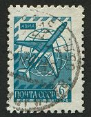 USSR - CIRCA 1976: A stamp printed in USSR shows image of the Tu-154 airliner and Globus, circa 1976.
