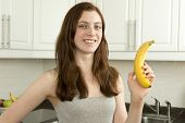 Young Woman Holds Banana
