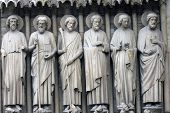 Paris, Notre-Dame cathedral, detail of central portal, depicting the Last Judgment. From left to right: Bartholomew, Simon, James the Less, Andrew, John, and Peter.