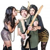 image of groupies  - Sexy groupies around smoking heavy metal guitarist - JPG