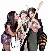 stock photo of groupies  - Rock guitar player with two beautiful female fans - JPG
