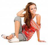 Teenage Girl sitting. White Background. Teenager