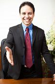 stock photo of funeral home  - Portrait of a smiling man in his studio - JPG